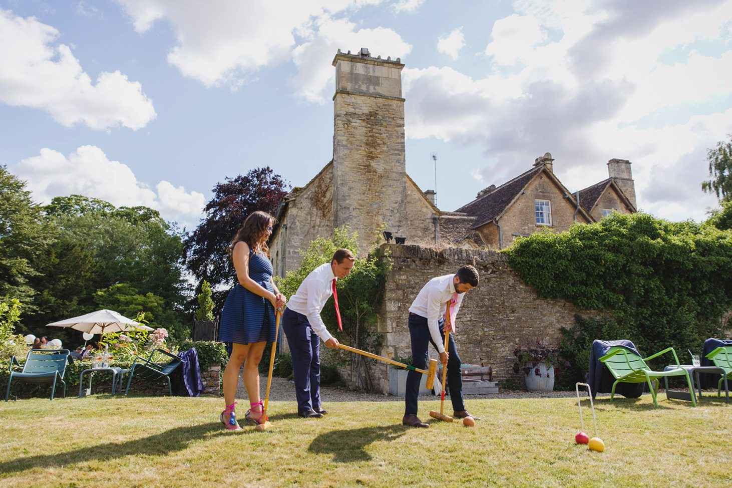 guests playing croquet at the rectory hotel crudwell wedding guest croquet