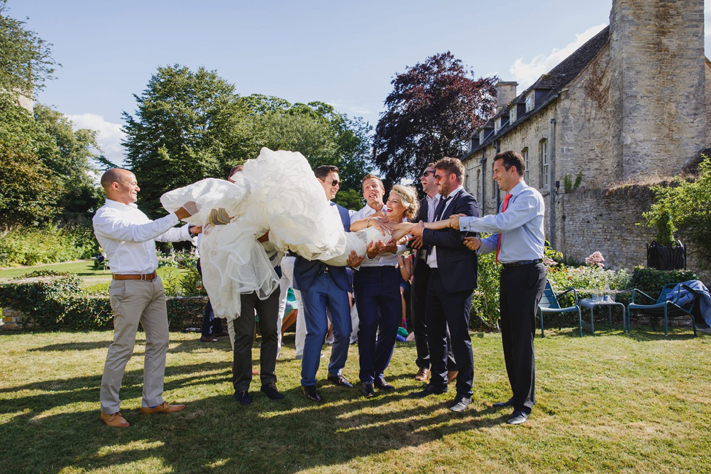 The Rectory Hotel Crudwell guests lifting bride