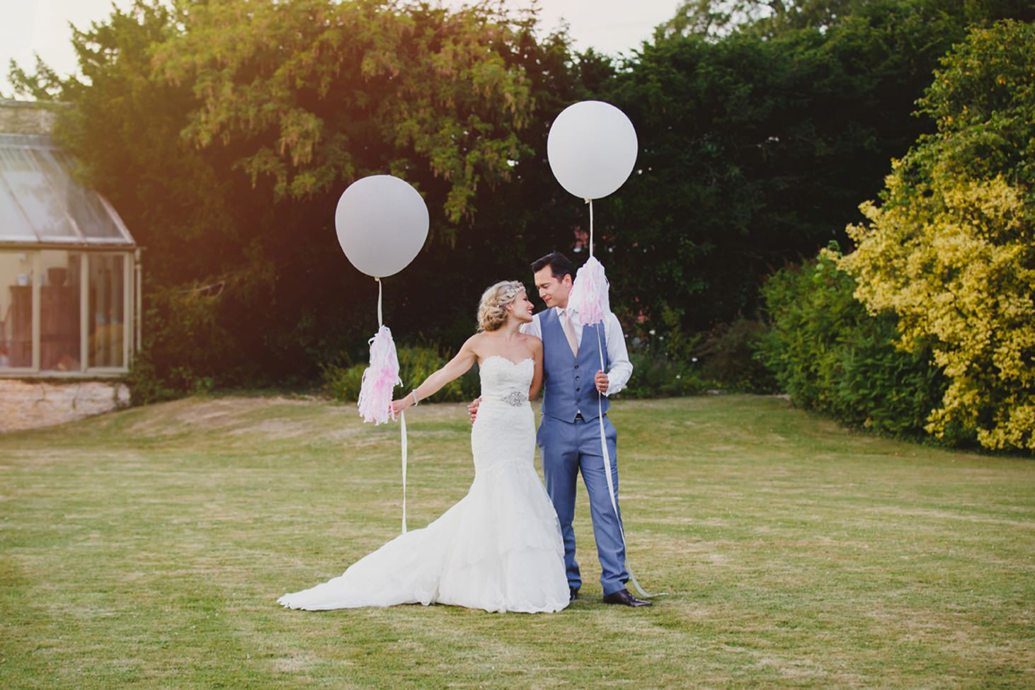 The Rectory Hotel Crudwell bride and groom with balloons