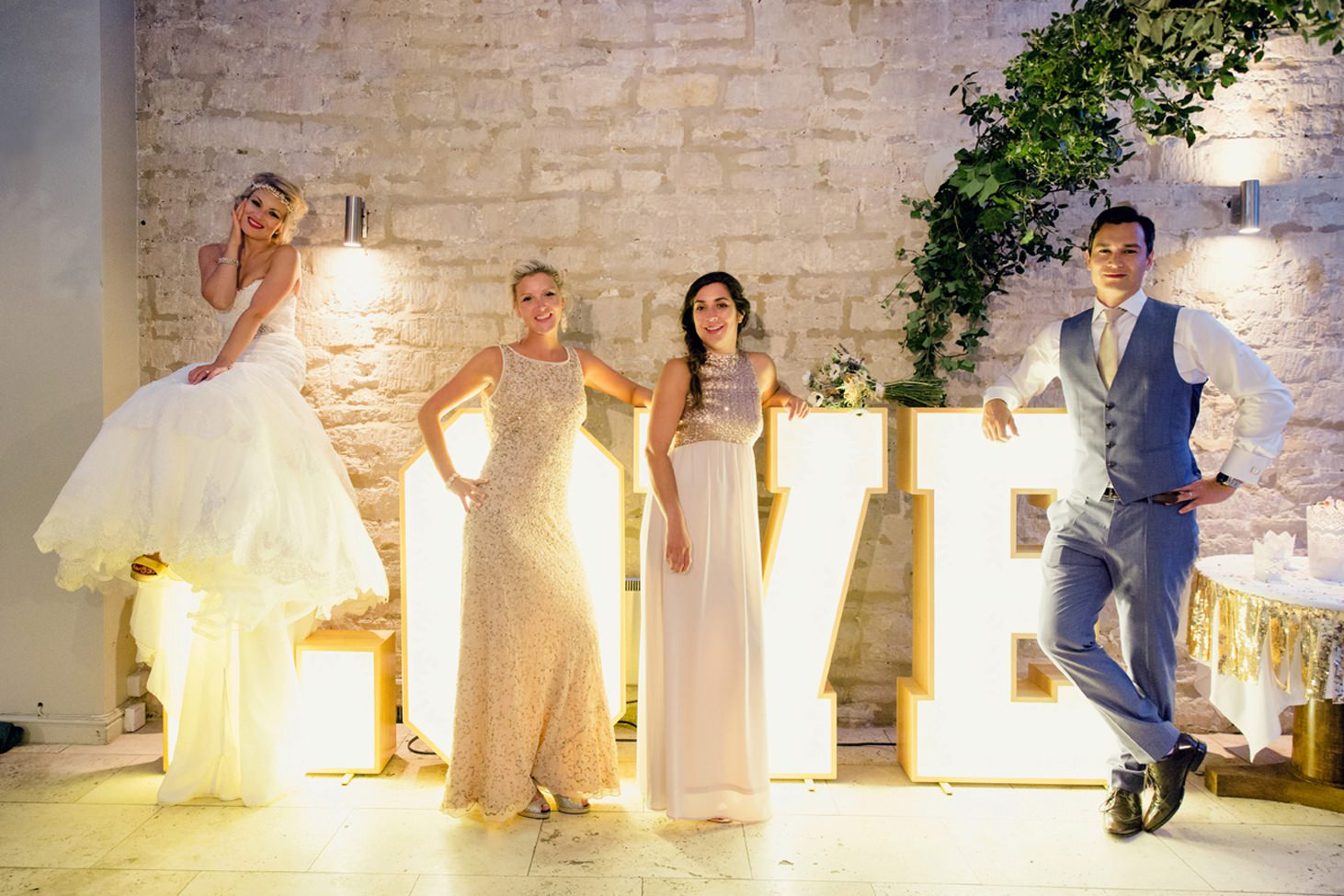 The Rectory Hotel Crudwell bridal party with light up sign