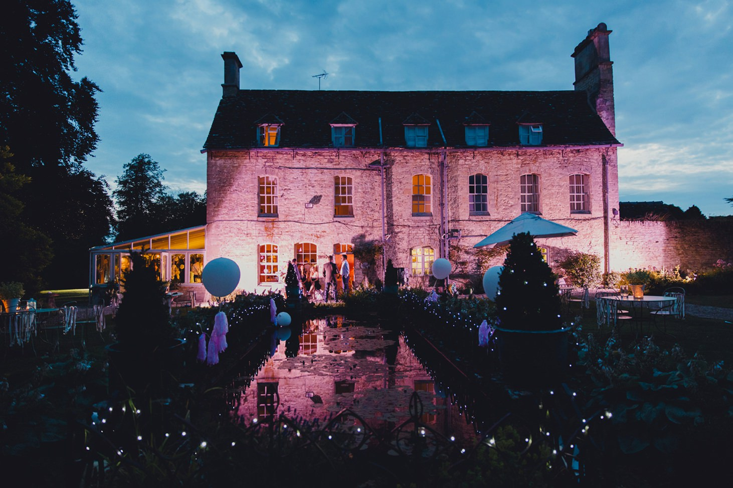 The Rectory Hotel Crudwell gardens at night