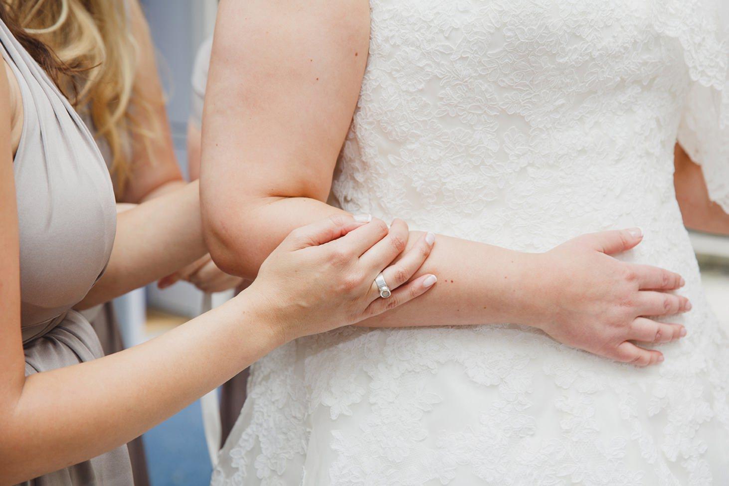 Wycombe Abbey wedding photography bridesmaids holding bride