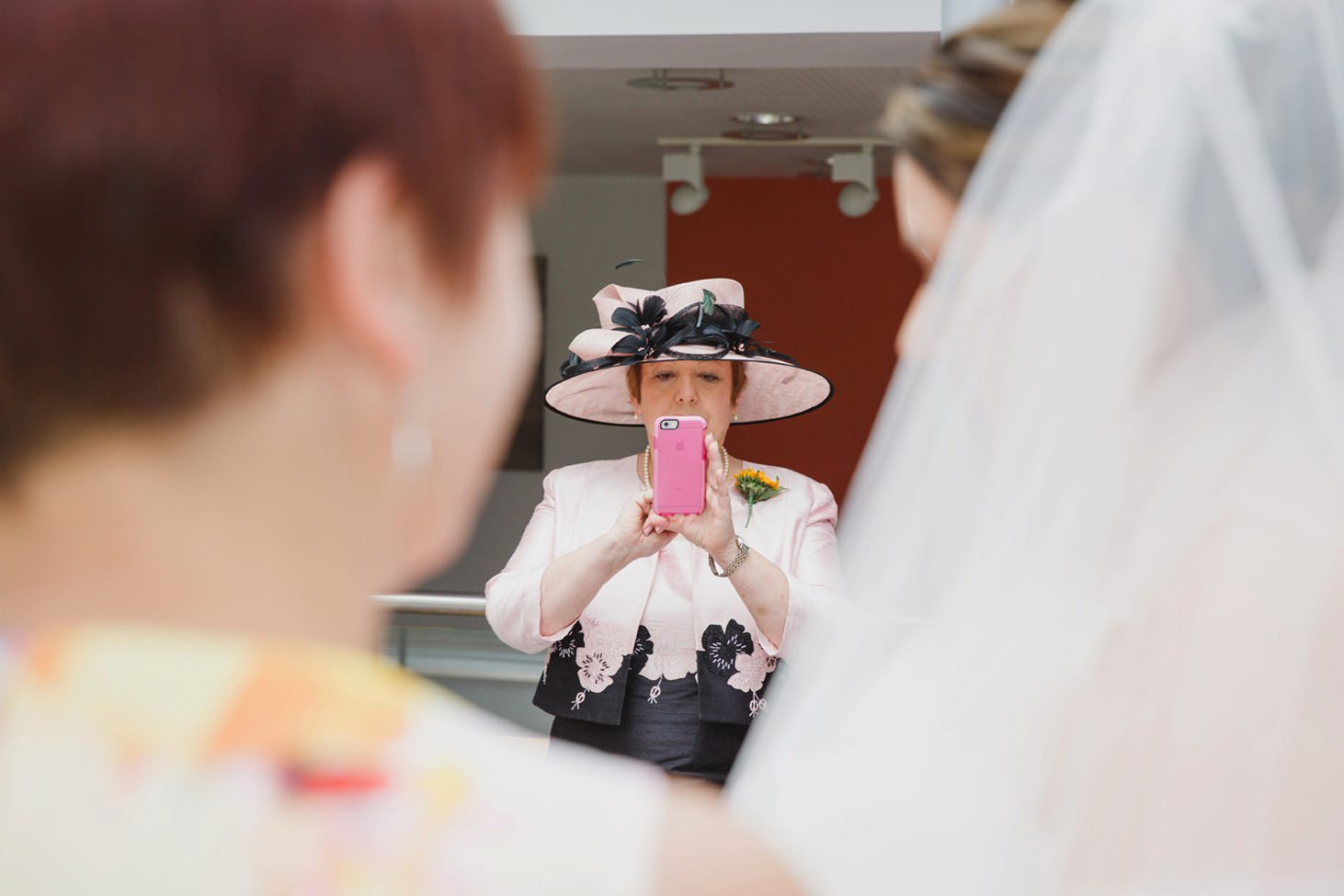 Wycombe Abbey wedding photography bride's mum taking picture