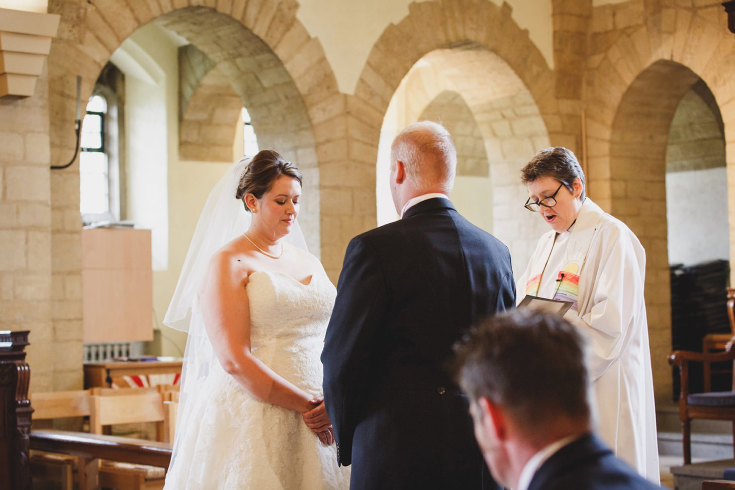 Wycombe Abbey wedding photography bride and groom exchange vows