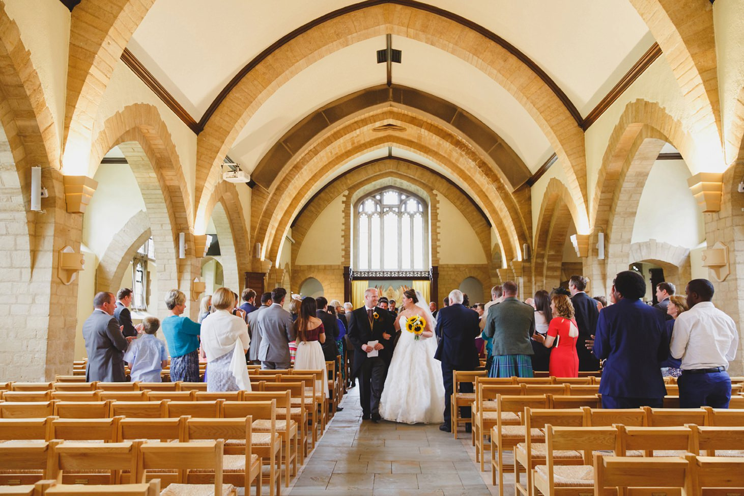 Wycombe Abbey wedding photography bride and groom walking down aisle