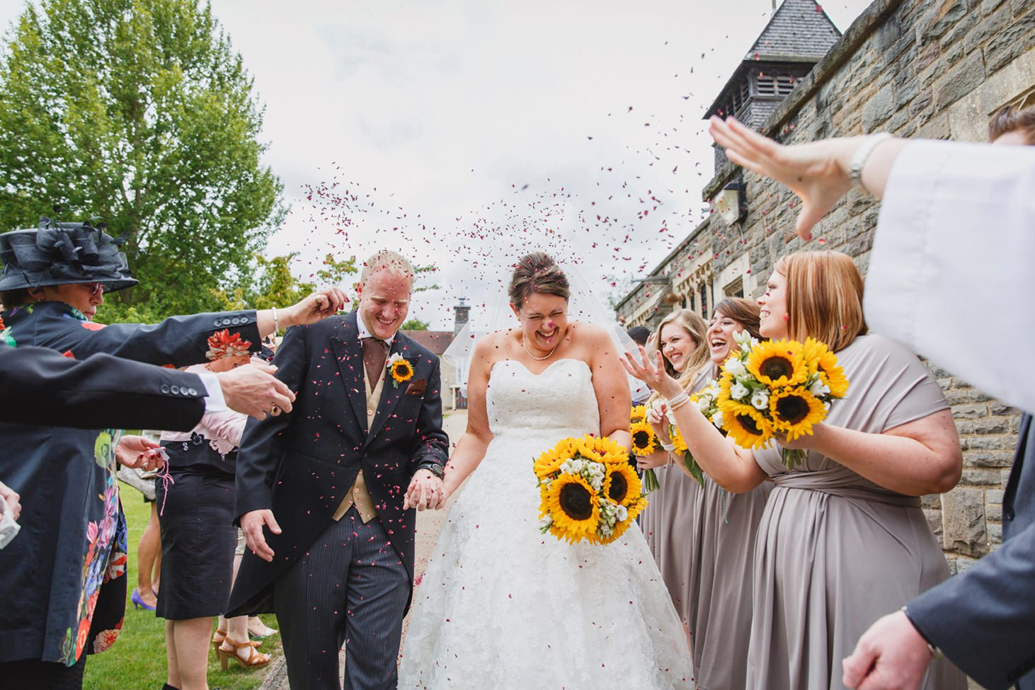 Wycombe Abbey wedding photography bride and groom in confetti