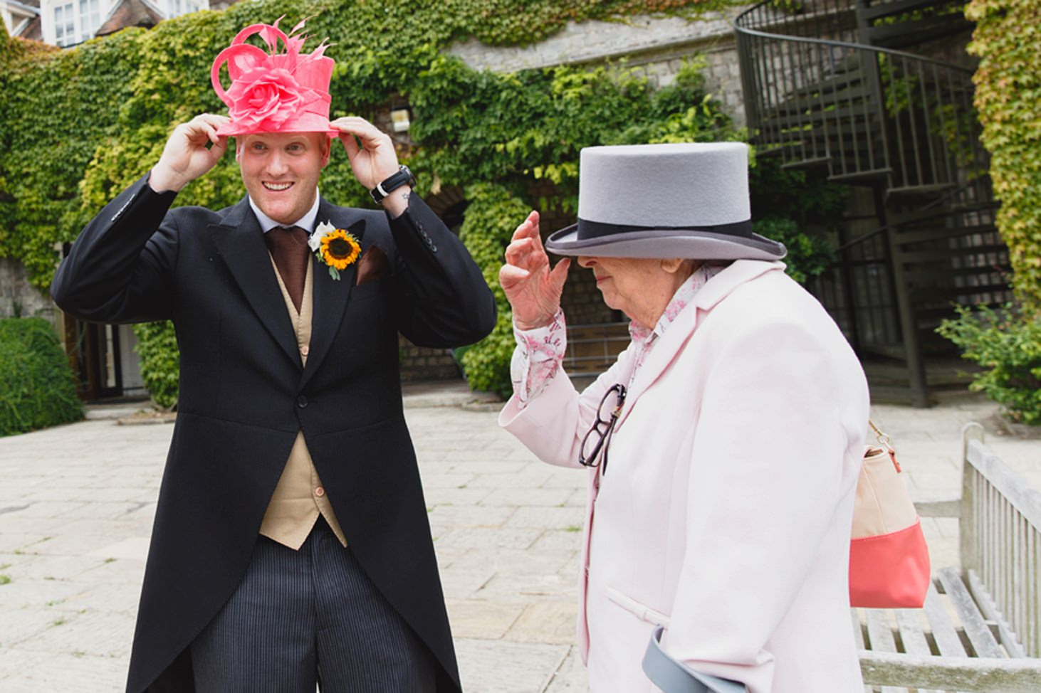 Wycombe Abbey wedding photography groom and grandparents swapping hats