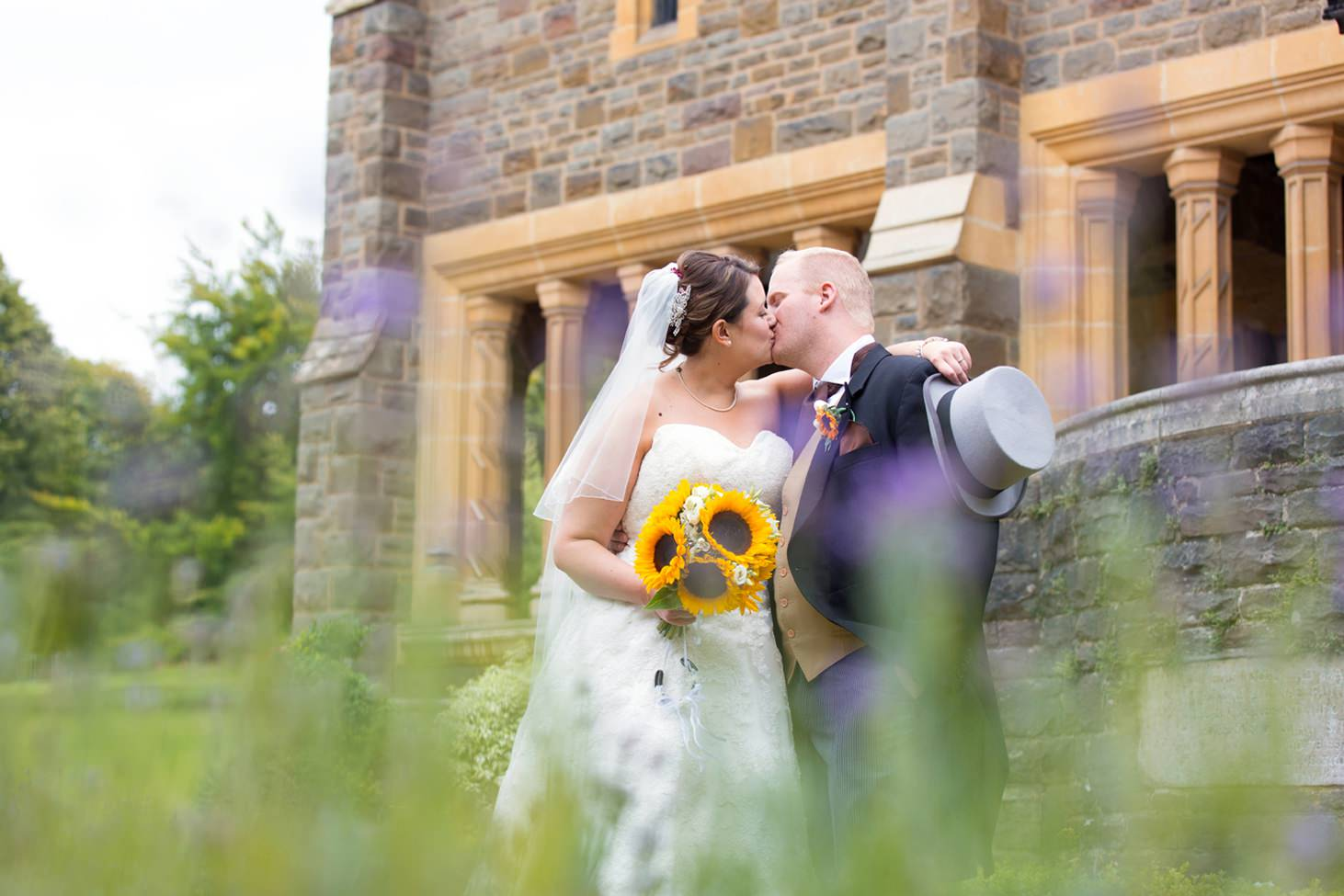 Wycombe Abbey wedding photography bride and groom kissing