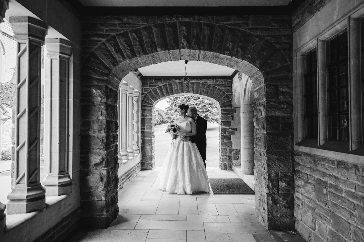 Wycombe Abbey wedding photography bride and groom together under archway