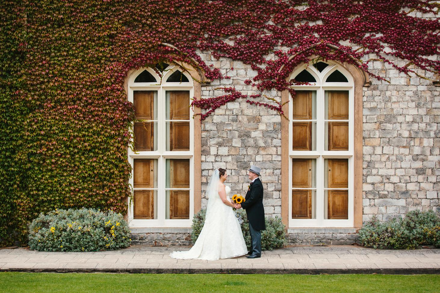 Wycombe Abbey wedding photography bride and groom by autumn leaves