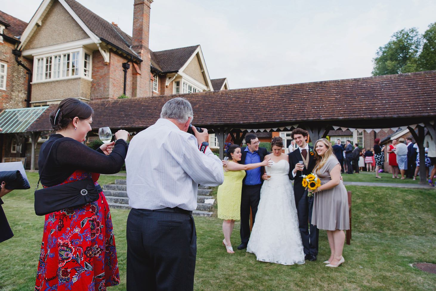 Wycombe Abbey wedding photography guests taking pictures