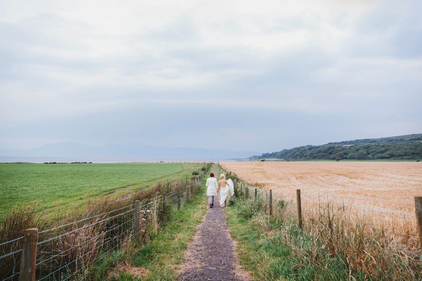 isle of bute wedding photography bride and groom walking along path