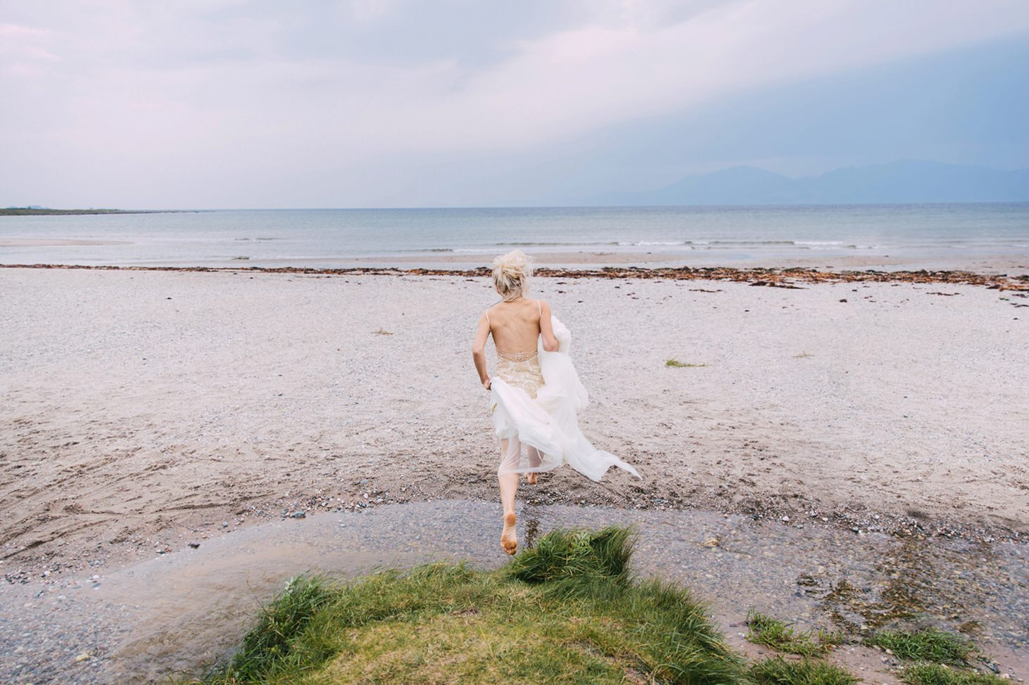 isle of bute wedding photography bride jumping on beach