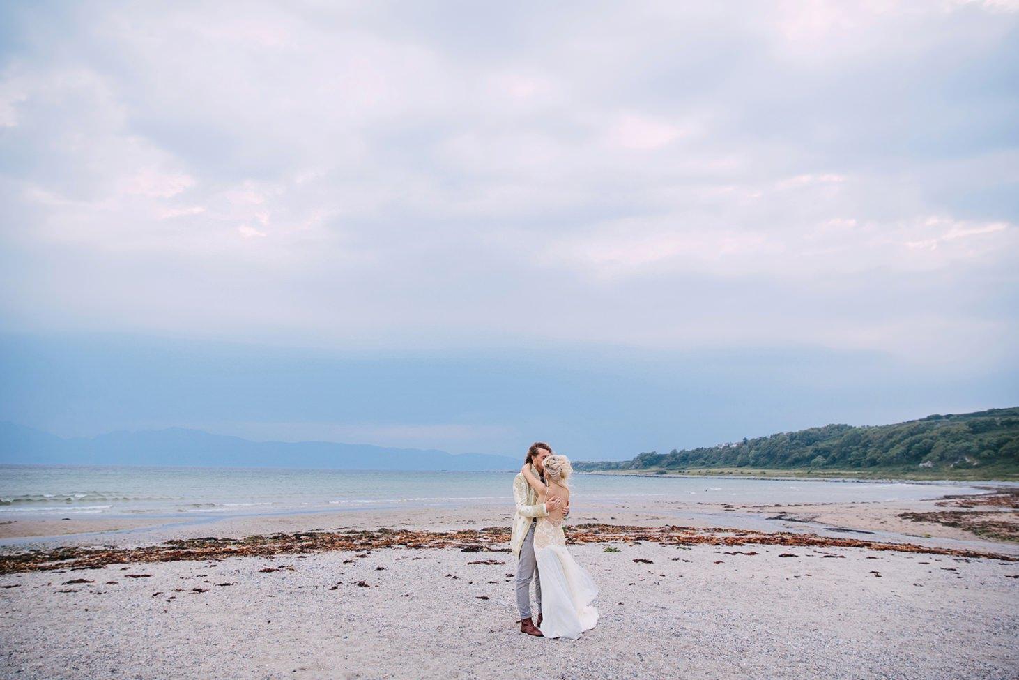 sle of bute wedding photography wedding couple on beach