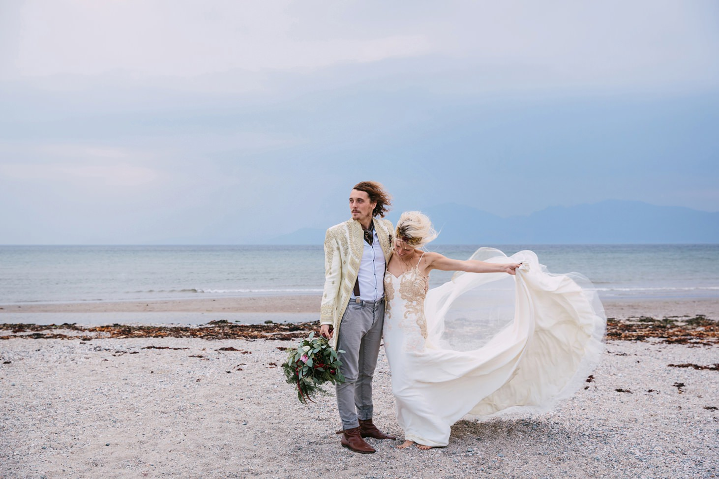 sle of bute wedding photography bride and groom on windy beach