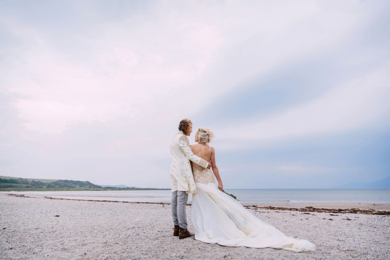 sle of bute wedding photography bride and groom look out to sea