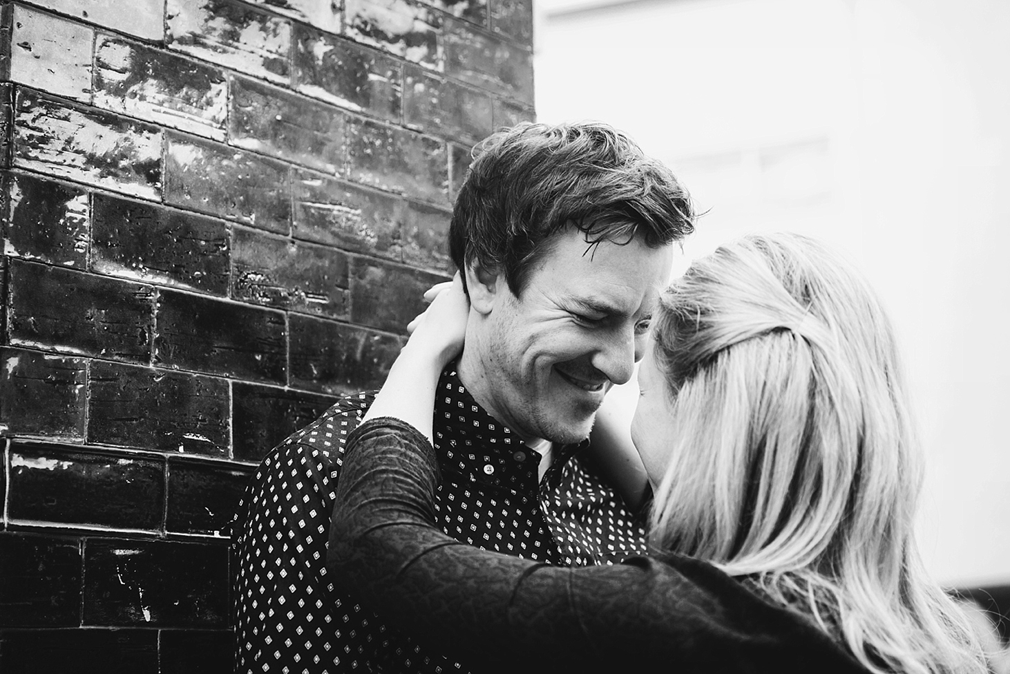 shoreditch engagement photography couple by building wall