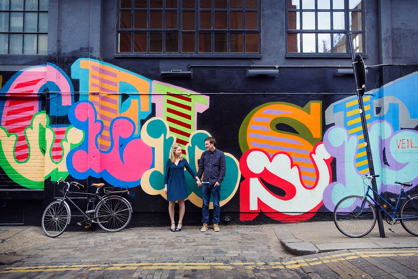 shoreditch engagement photography couple by graffiti wall