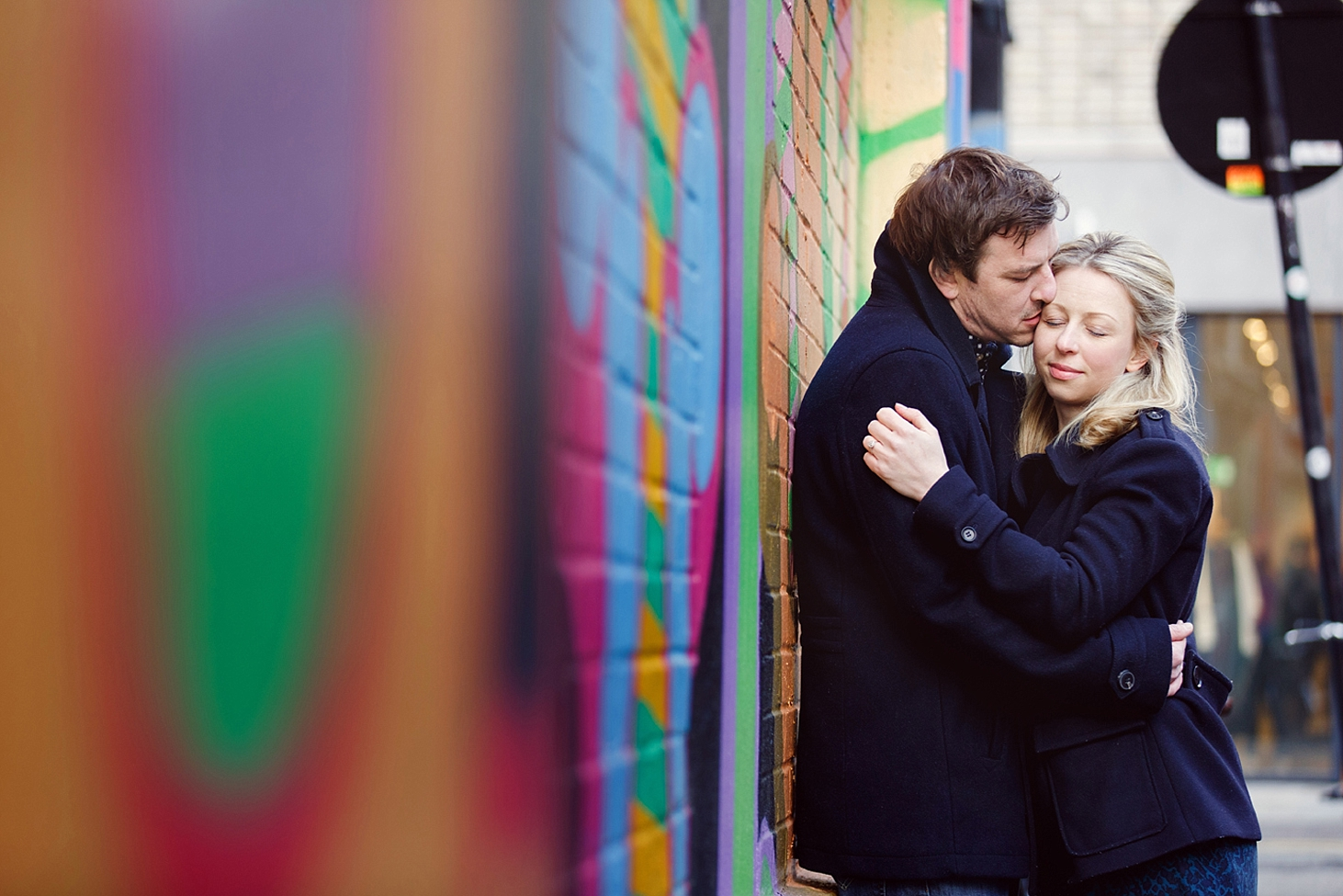 shoreditch engagement photography couple hug by wall