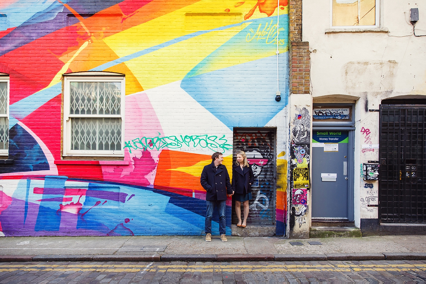 shoreditch engagement photography couple by colour wall