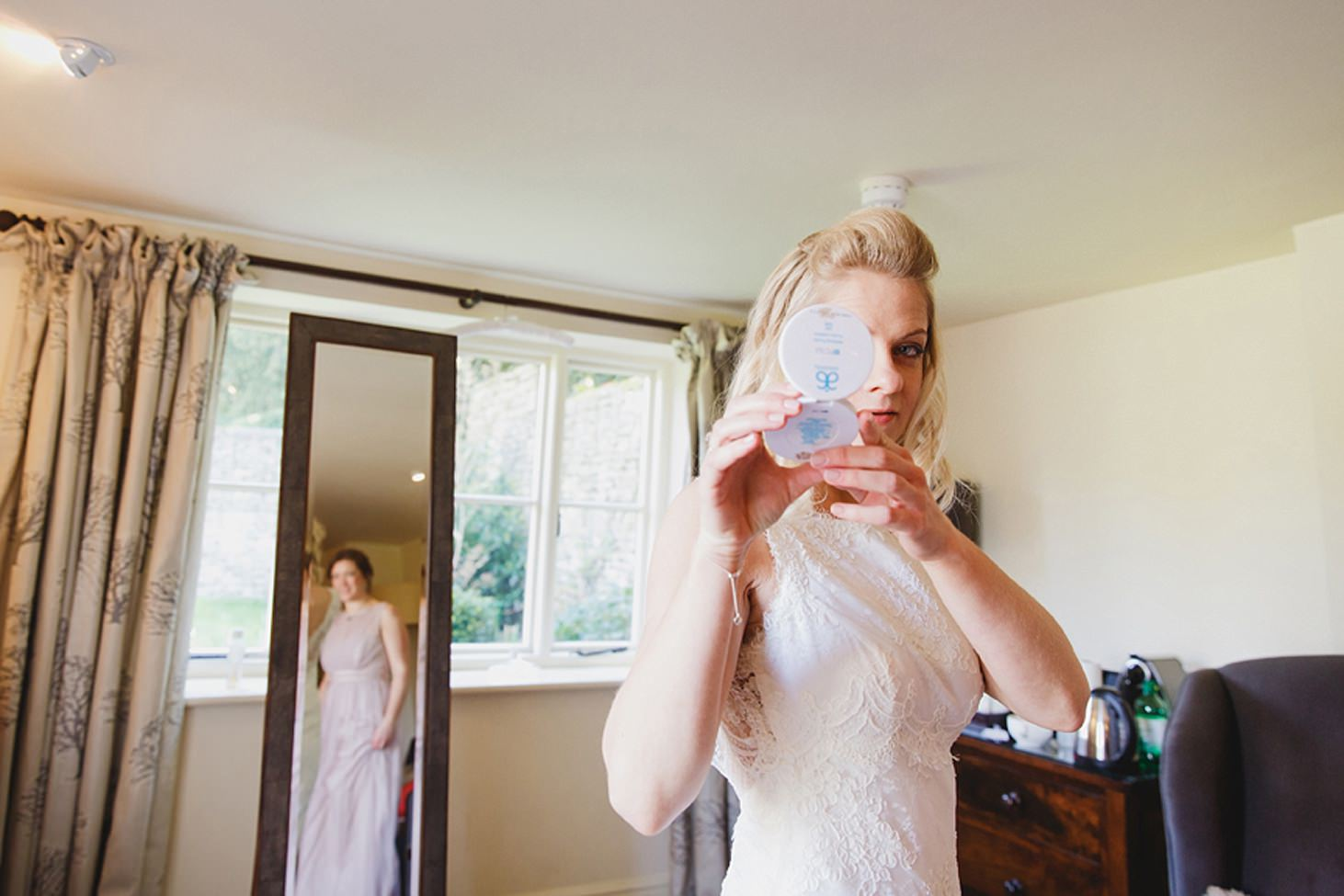cotswolds wedding bride looking in mirror