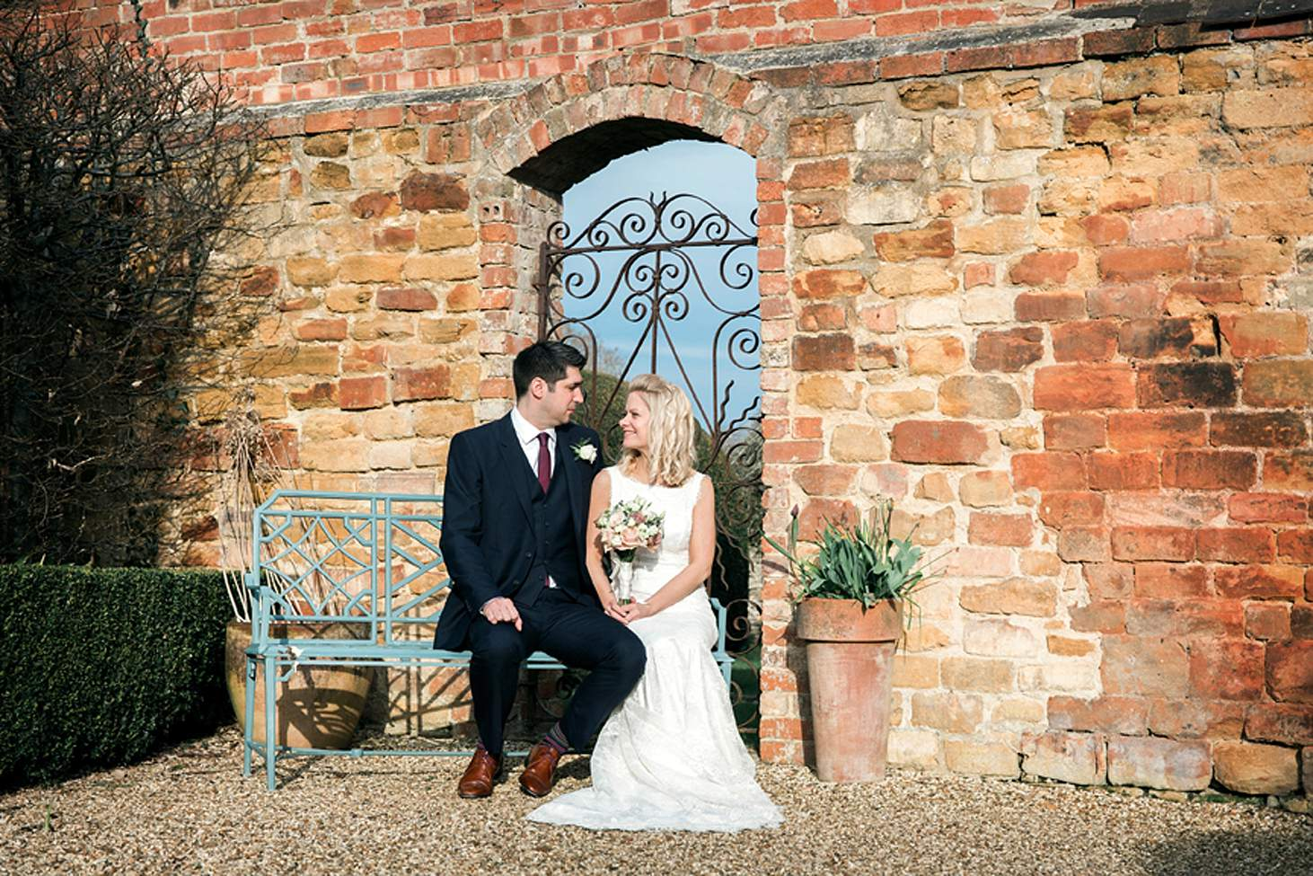 cotswolds wedding bride and groom on bench