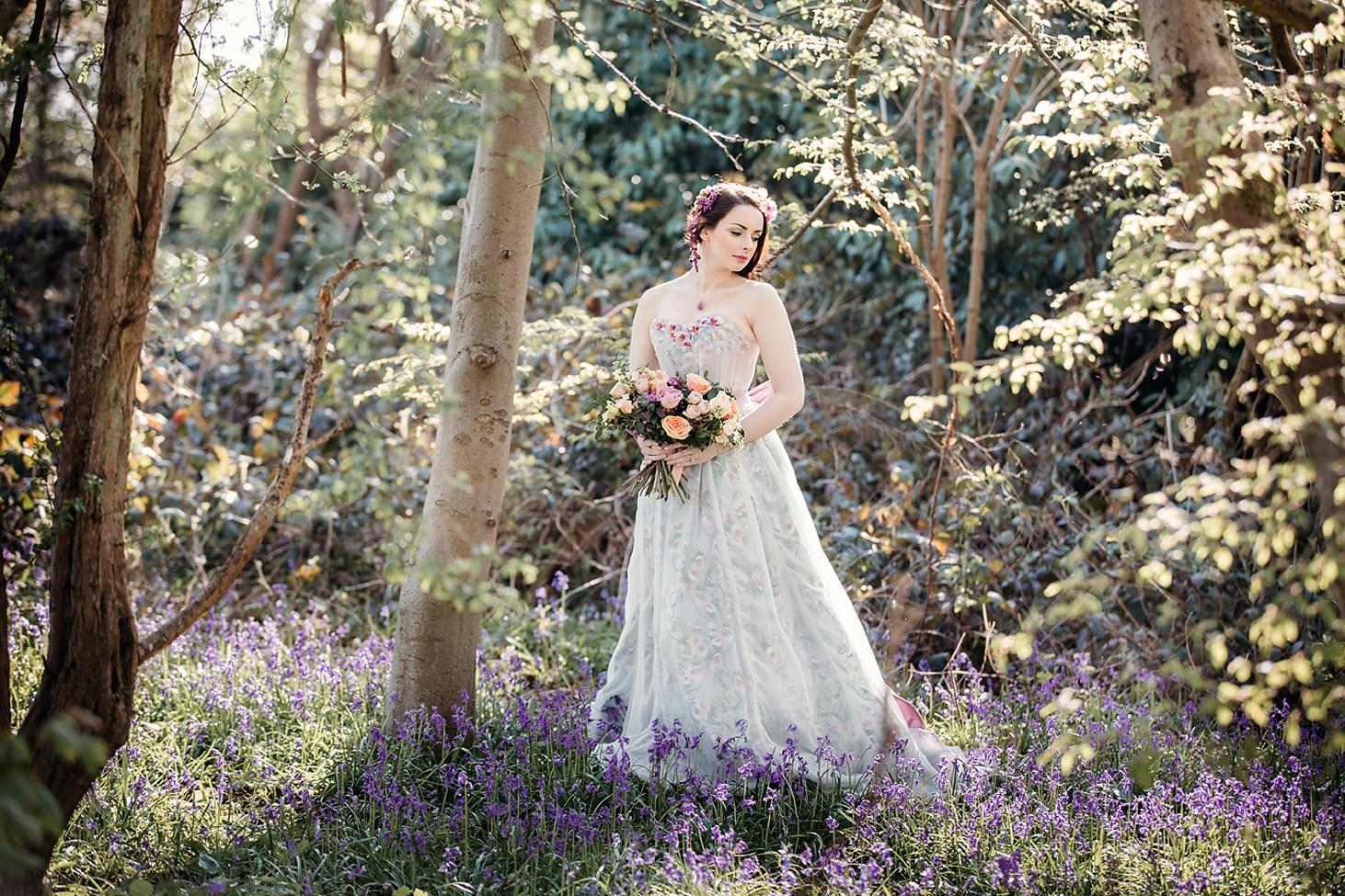 spring bride amongst bluebells