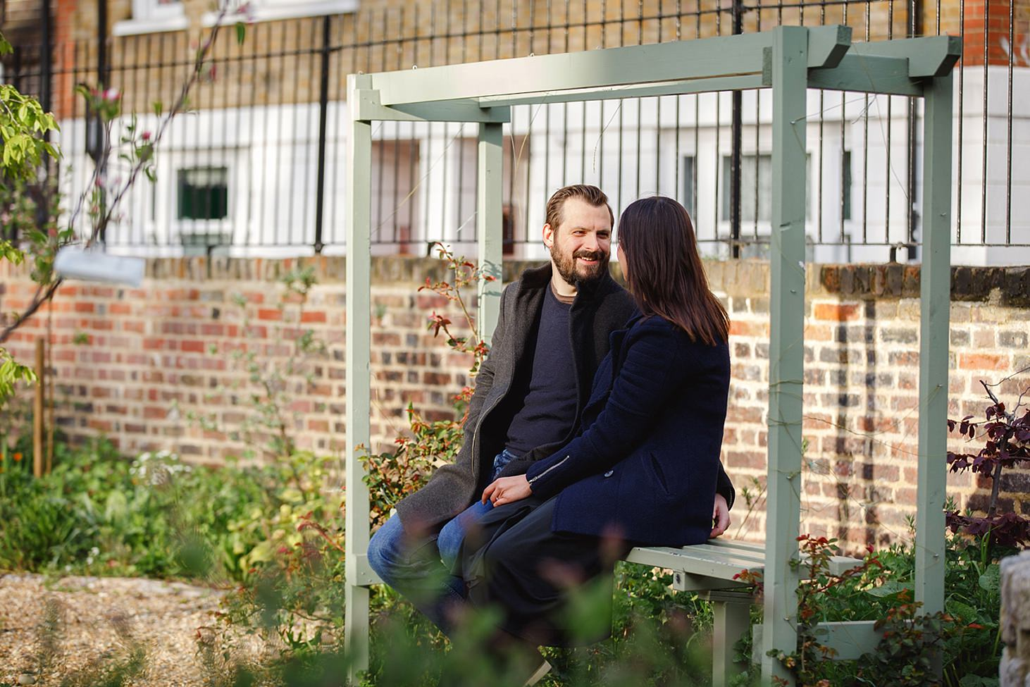 shoreditch engagement shoot couple on bench