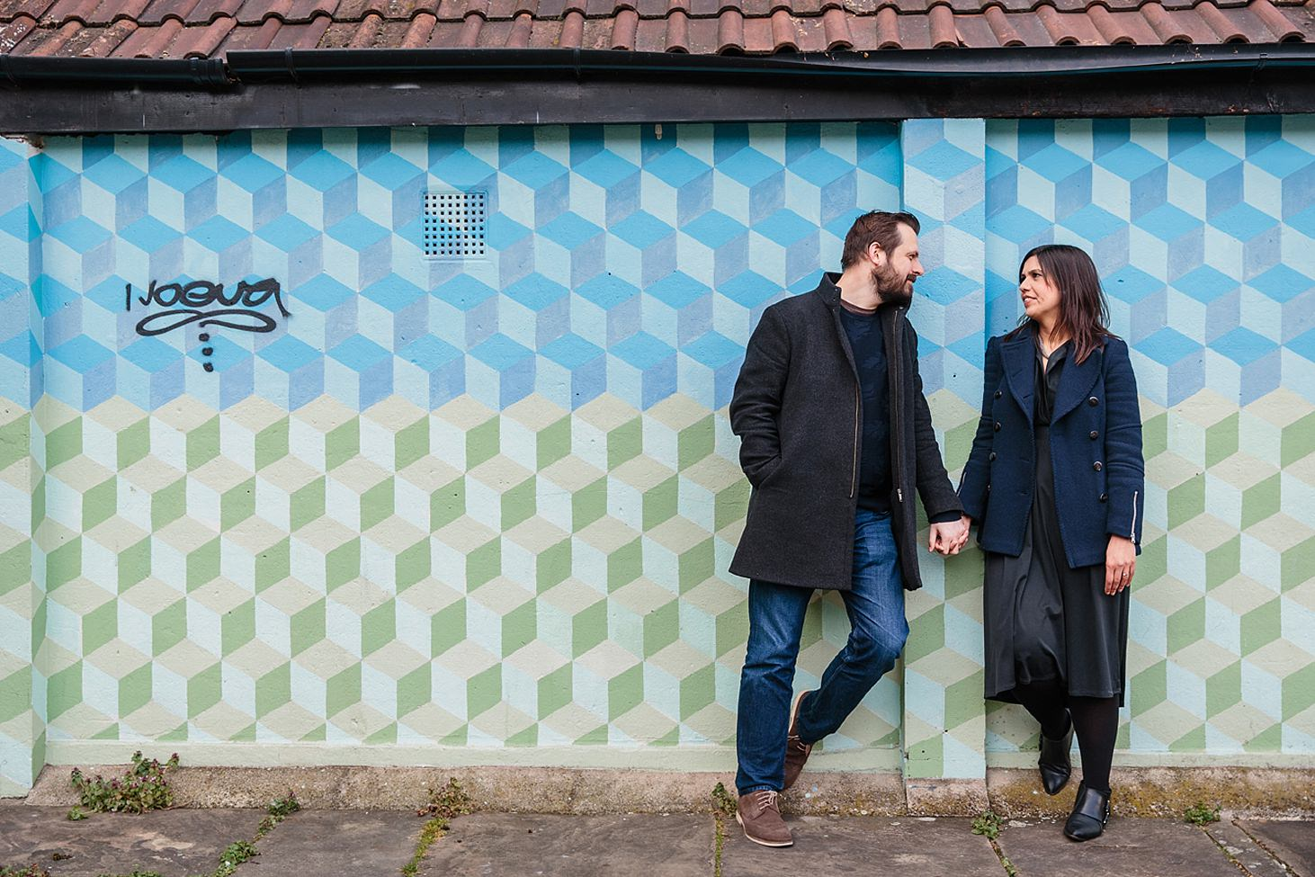 shoreditch engagement shoot couple by blue wall