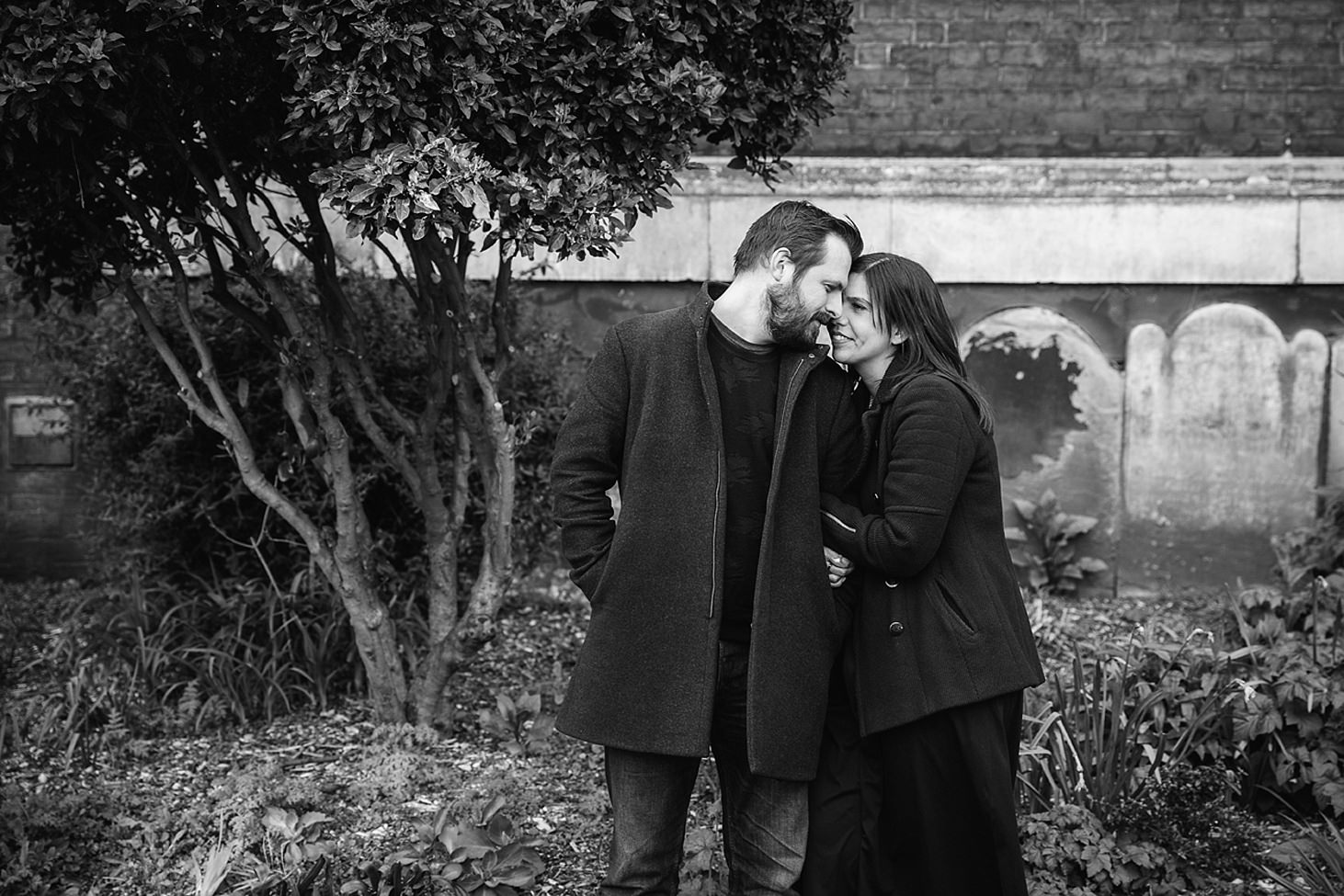 shoreditch engagement shoot couple huggung together