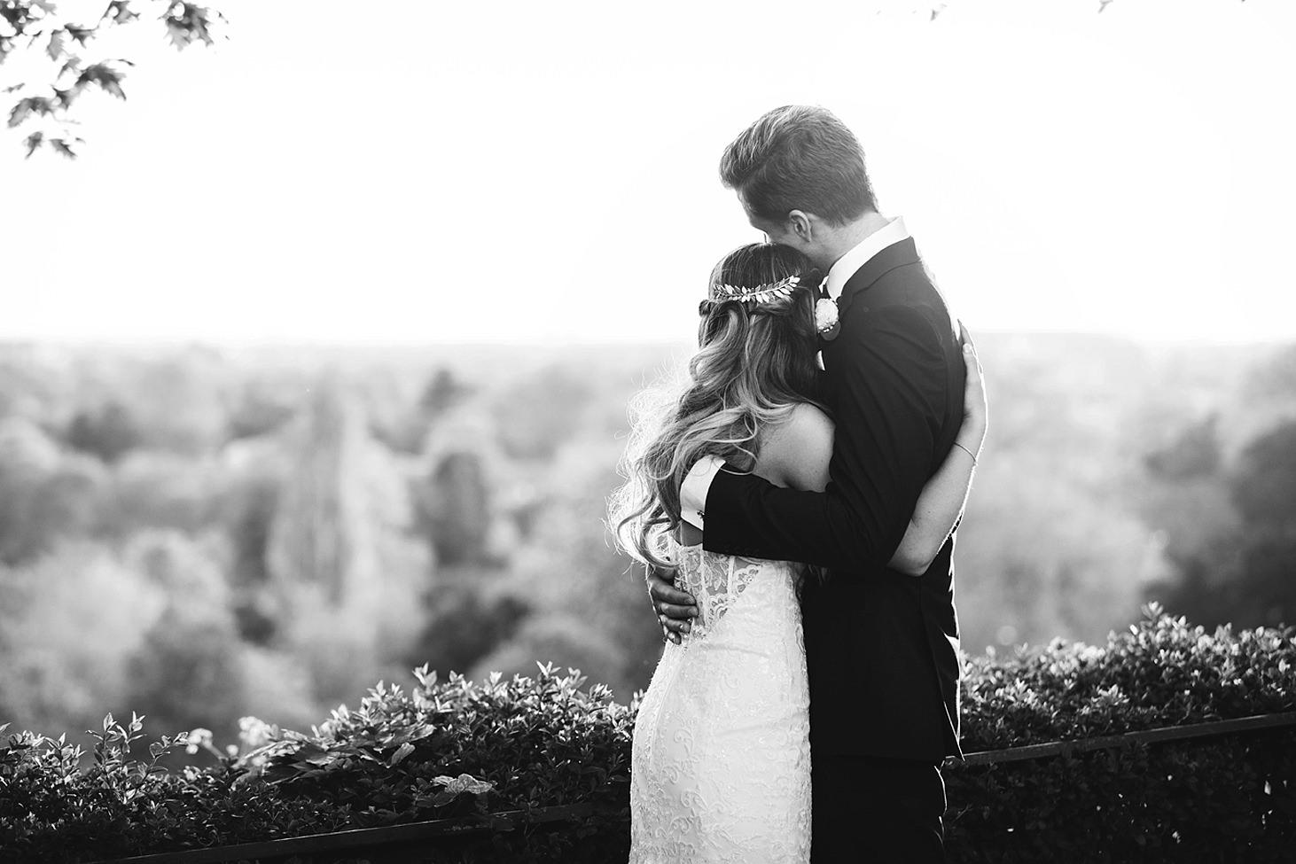 richmond hill wedding photography bride and groom hug on terrace