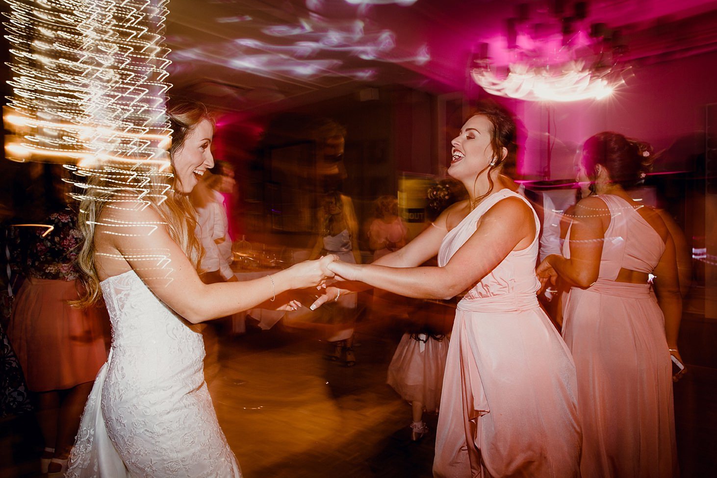 richmond hill wedding photography bride and bridesmaid dancing