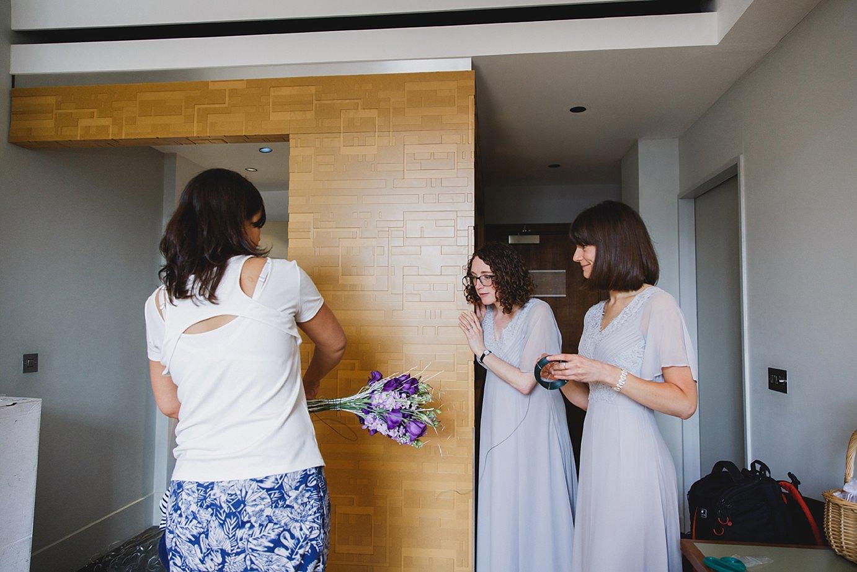 Londesborough pub wedding photography wedding photography bride making bouquet
