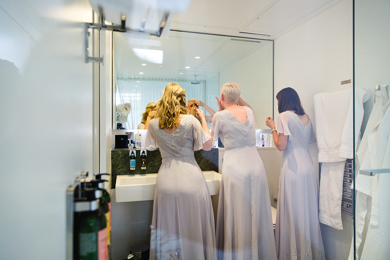 Londesborough pub wedding photography wedding photography bridesmaids putting on bindis