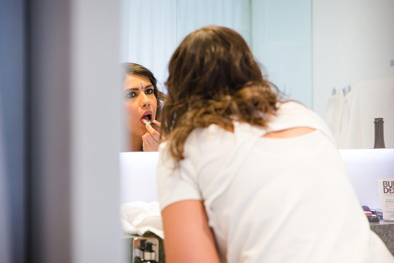 Londesborough pub wedding photography wedding photography bride putting on lipstick