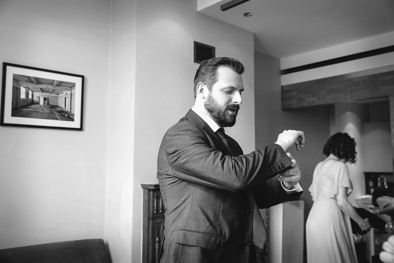 Londesborough pub wedding photography wedding photography groom fixing cufflinks
