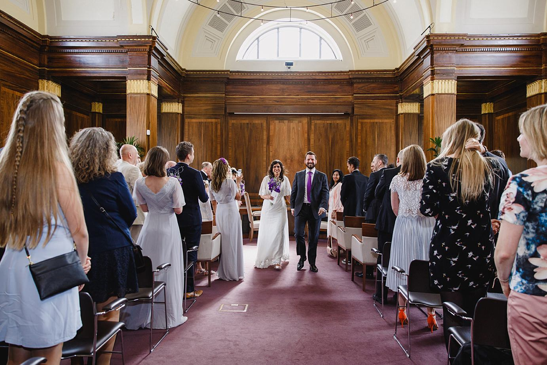 Londesborough pub wedding photography bride and groom walking down aisle