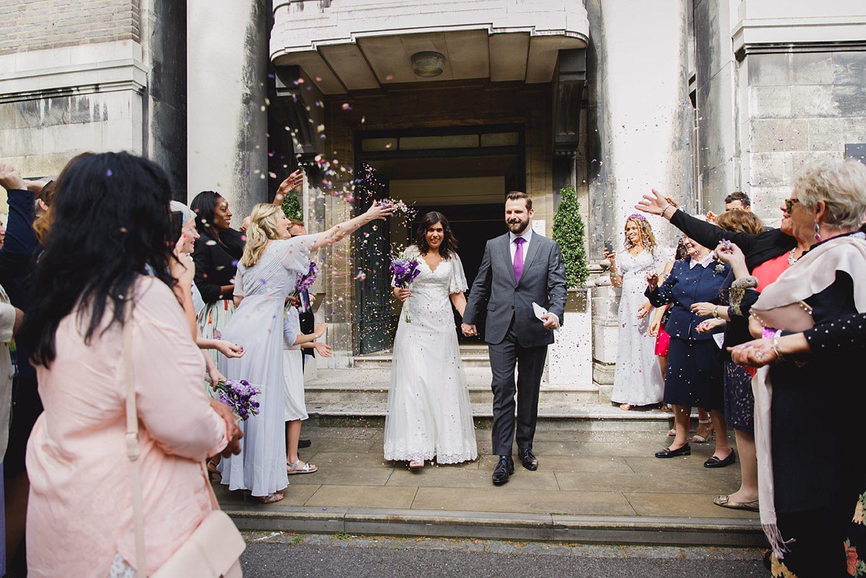 Londesborough pub wedding photography bride and groom in confetti
