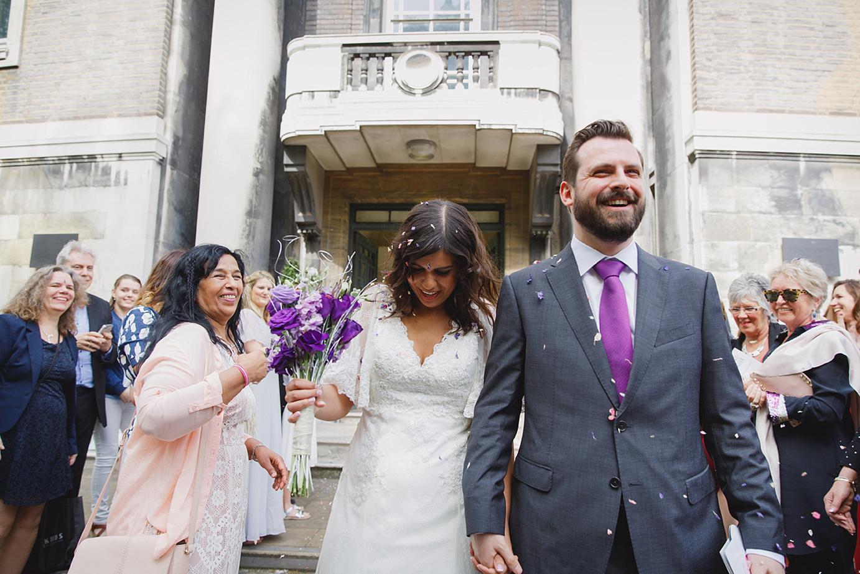 Londesborough pub wedding photography bride and groom walking through confetti