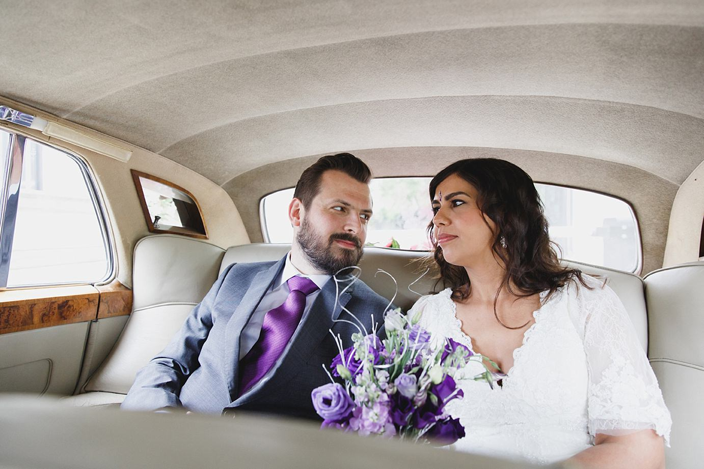 Londesborough pub wedding photography bride and groom inside wedding car