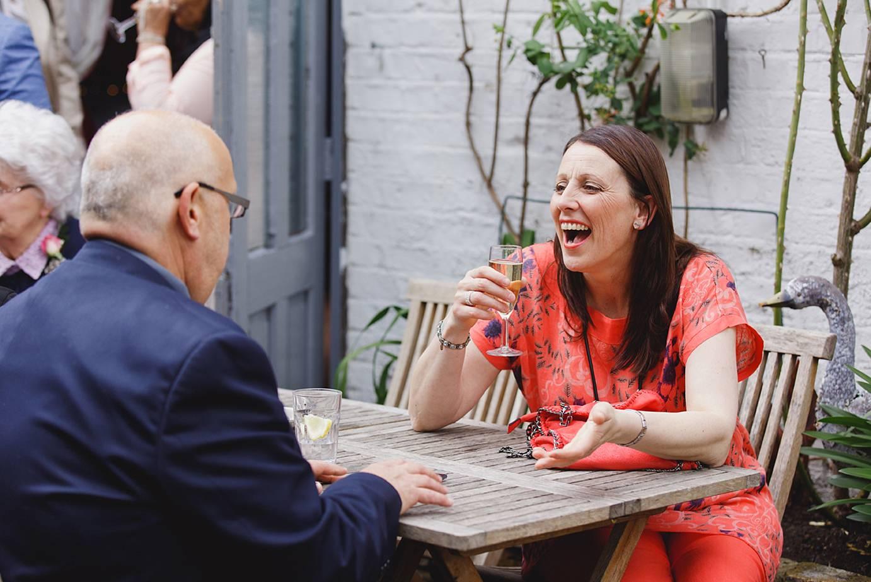 Londesborough pub wedding photography wedding guests laughing