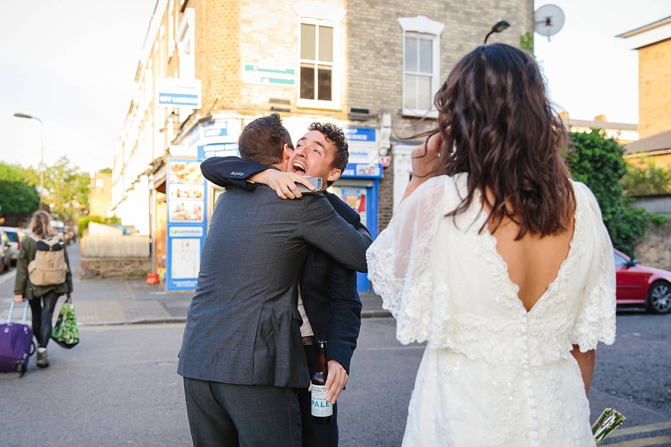 Londesborough pub wedding photography groom hugging friend