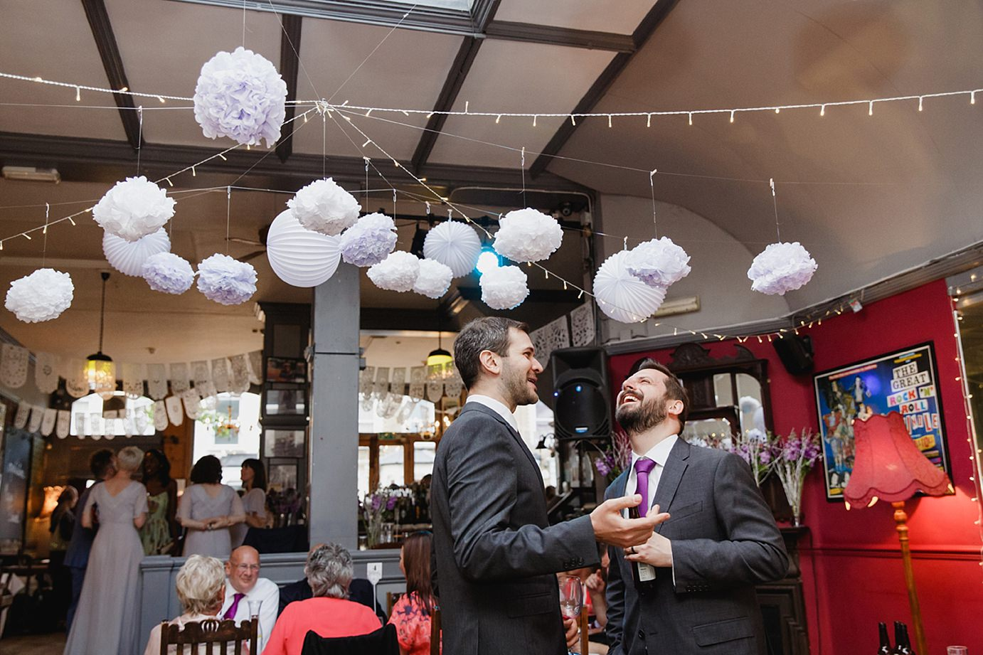 Londesborough pub wedding photography groom laughing with guest