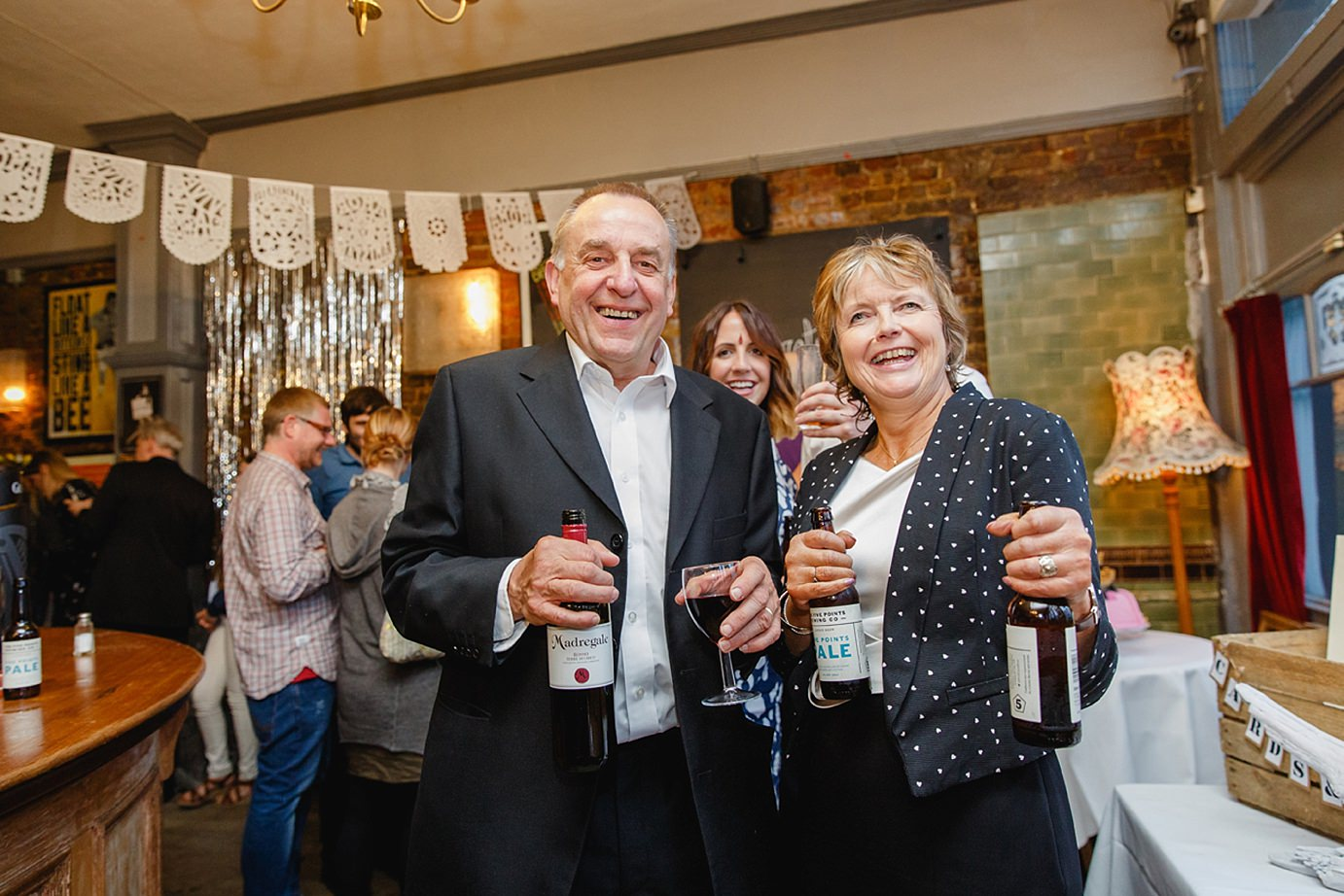 Londesborough pub wedding photography guests with beer bottles