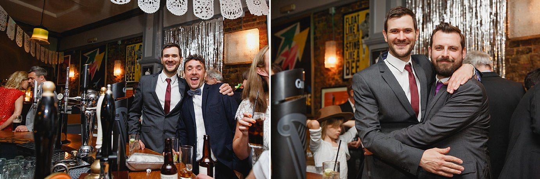Londesborough pub wedding photography wedding guests at bar