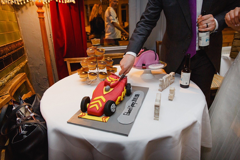 Londesborough pub wedding photography groom cutting cake