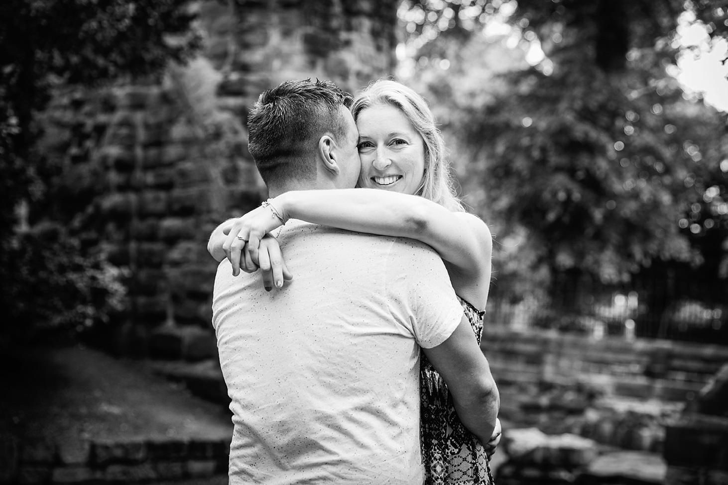 chester engagement shoot bride hugging groom