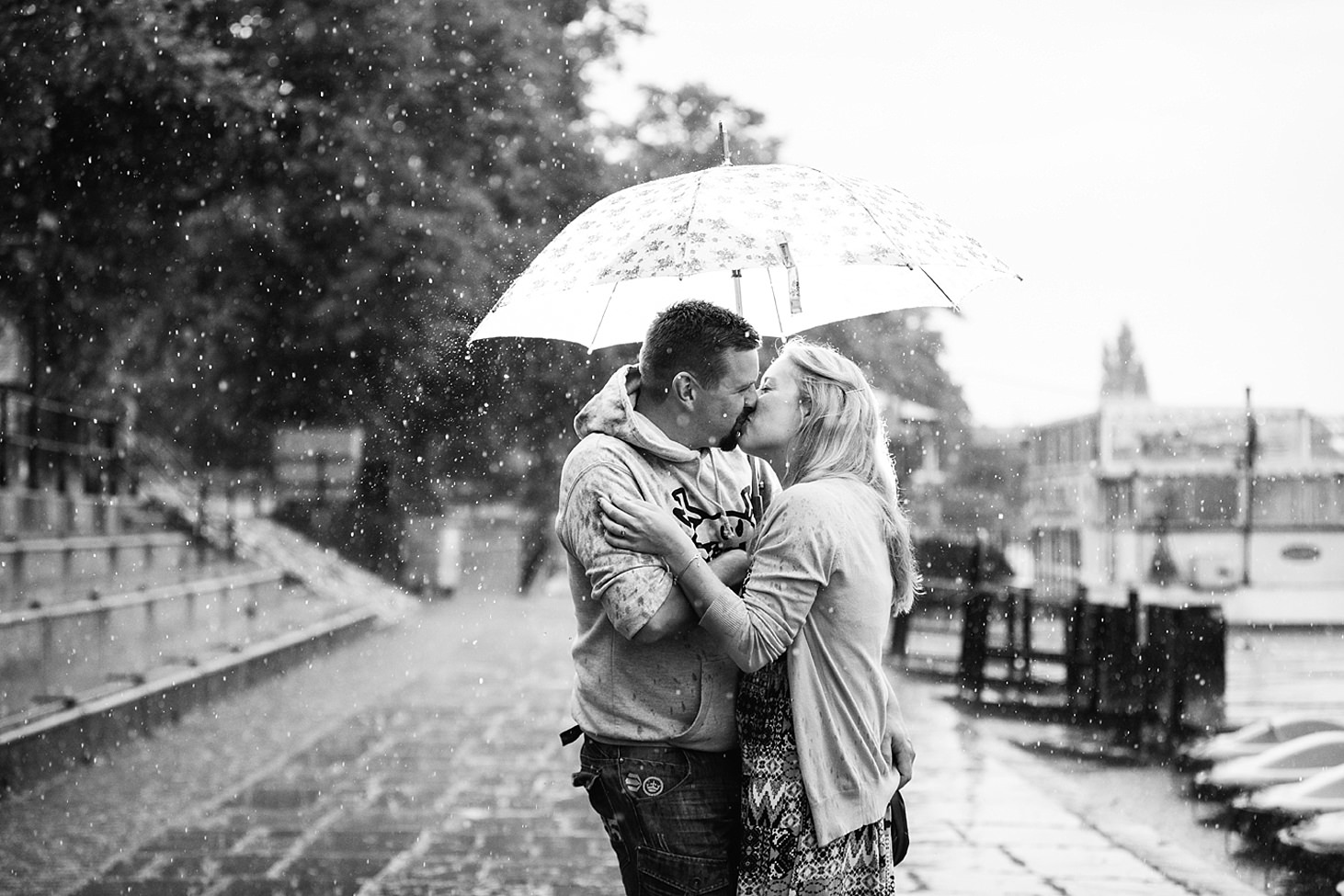 chester engagement shoot couple kiss in the rain
