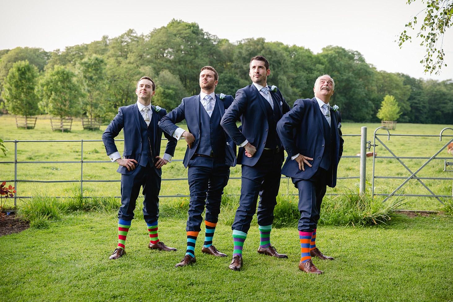 gate street barn wedding photography groomsmen in stripy socks