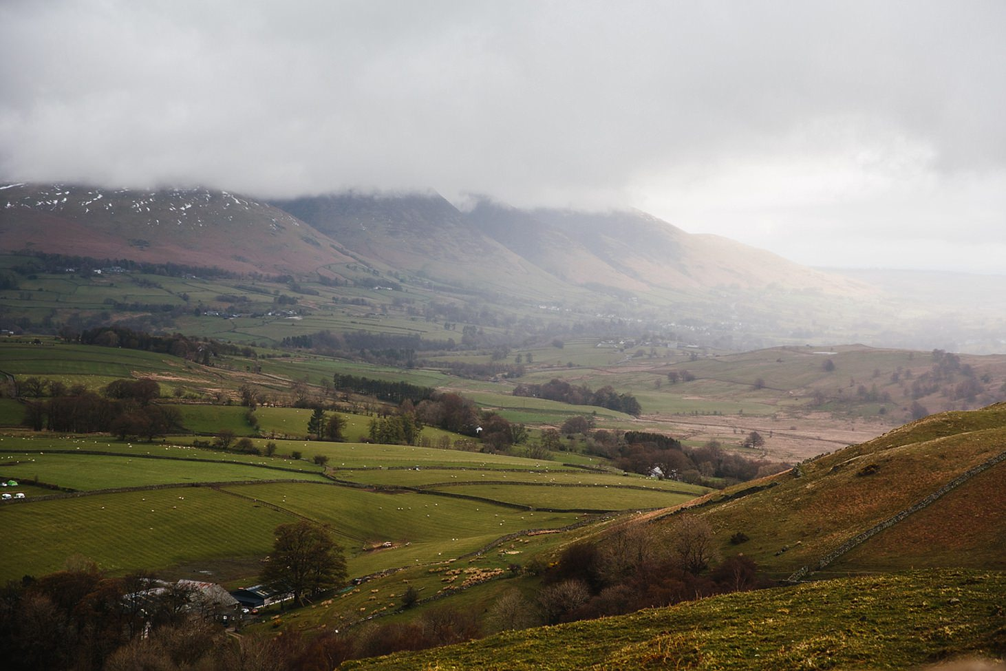lake district travel photography view of fells in rain